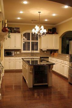 white kitchen cabinets - dark countertops