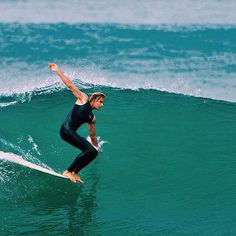 Awesome hang ten by Corey Colapinto. Great photo by Rick Bickford via Canvas Surfboards.