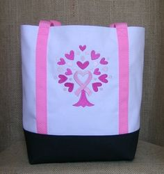 This handmade embroidered tote was made to show awareness. The design of  pink hearts and 195574e76d4