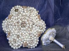 Pearl brooch bouquet - fascinating and beautiful with diamante accents. Wedding Brooch Bouquets, Pearl Brooch, Autumn Theme, Pearls, Beautiful, Wedding Bouquets, Pearl, Pearl Beads, Beads