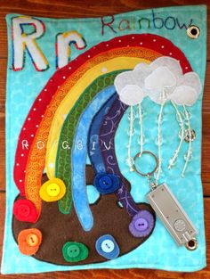 "Amazing- rainbow with crystal beads and a flashlight so that the ""raindrops"" make little rainbows on the wall.  So cool!  [I don't know if I'll ever ""be done"" making these books]"