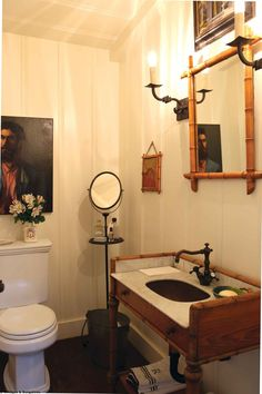 Designer Randy Boyd creates authentic cottage style in his 1920s era cottage in Laguna Beach. Antique faux bamboo mirror & re-purposed washstand add to the charm of this vintage bath.