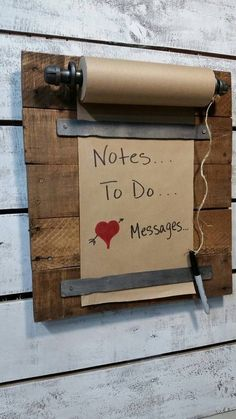 Rustic memo board from reclaimed wood, pipe and metal.
