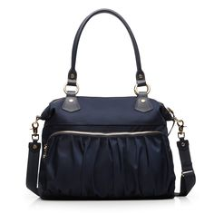Modeled after the favorite Jane, the Belle is a large everyday bag fit for your work-to-gym routine, a day of classes, or a quick weekend getaway. With rolled Italian leather shoulder handles and an optional crossbody strap.  In Dawn Bedford Nylon with custom MZ Wallace gold hardware, it's perfect for every season.