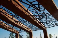 Landscape Design - Timber pergola with custom designed corten 'Falling Leaves' screens