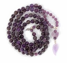 Amethyst enhances intuition and facilitates communication. The healing properties of this stone help clear the mind of negative thoughts.  Lepidolite is a calming and soothing stone that gives relief from stress, anxiety and depression.  Each Mala is hand-knotted with 108 beads gemstone beads.  Our Amethyst Mala is finished with a raw piece of Amethyst, and a carved Amethyst Wing with sterling silver wire detail and silver beads. Metal Beads, Silver Beads, Raw Amethyst, Negative Thoughts, Intuition, Calming, Gemstone Beads, Natural Gemstones, Depression