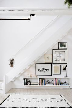 art gallery under staircase