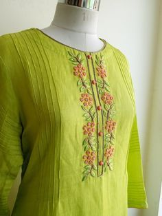 Fresh leaf green Kurta in Linen Silk with Intricate Knot work and Pintucks Detailing. Kurti Embroidery Design, Hand Embroidery Dress, Embroidery Neck Designs, Embroidery On Clothes, Embroidery Fashion, Silk Kurti Designs, Churidar Designs, Kurta Designs Women, Dress Neck Designs