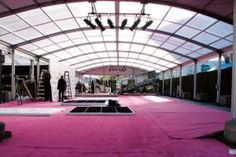 Tent companies cite an increase in requests for the Arcum tent, which has an arched beam and provides an alternative look to the traditional clearspan structure. Hollywood Tentworks in Pacoima, California, constructed an Arcum tent at L.A. Live for the 2011 N.B.A. All-Star Game.