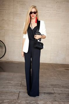 So chic.  Black, white, polkas and a pop of red in an unexpected place.