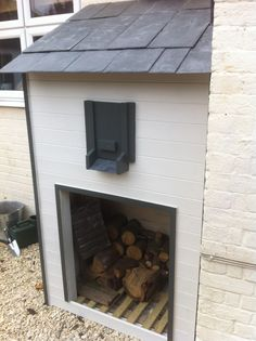 Log and Coal store Idea for duel fuel stoves. The coal bunker is design so that when you open the shutter door and the coal flows out into your scuttle.