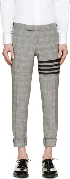 Thom Browne grey with Stripe on rousers,and four lines highlight the main detail of brand