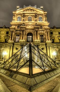 Paris: La Pyramide du Louvre. I know a lot of Parisians are unhappy with the style of architecture of the pyramid, but I think it would be beautiful to see.