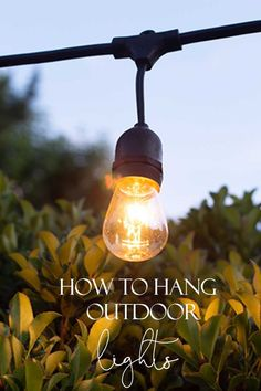How to Hang Outdoor String Lights - Happy Happy Nester - This tutorial shows How to Hang Outdoor String Lights for your summer patio. Learn how with step by step instructions on how to install a wooden post into cement. Outdoor Hanging Lights, Outdoor Light Fixtures, How To Hang Patio Lights, Patio String Lights, Wooden Posts, Patio Lighting, Lighting Ideas, Outdoor Projects, Diy Projects