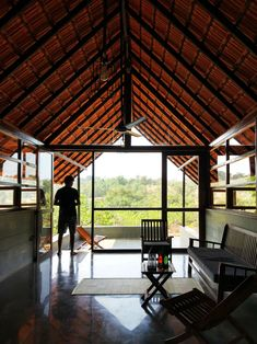 Image 9 of 26 from gallery of Vrindavan / unTAG. Photograph by unTAG Stone Wall Design, Eco Architecture, Vernacular Architecture, Casa Patio, Long House, Kerala House Design, Kerala Houses, Rustic Home Design, Courtyard House