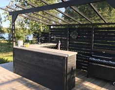 The wooden pergola is a good solution to add beauty to your garden. If you are not ready to spend thousands of dollars for building a cozy pergola then you may devise new strategies of trying out something different so that you can re Diy Pergola, Pergola Canopy, Pergola With Roof, Wooden Pergola, Outdoor Pergola, Pergola Kits, Outdoor Spaces, Outdoor Living, Outdoor Decor