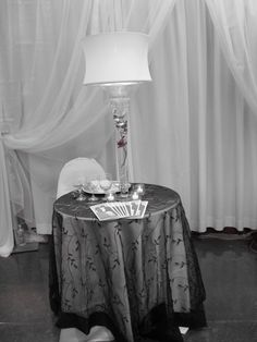 Love the table cloth and set up for the table to sign the book. I would have the book, bouquet, and candelabra...
