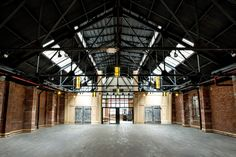 Renovated metal factory with industrial past features original brick walls, large wooden doors and high ceiling with sunny skylight. Perfect for weddings, Bar Mitzvahs, fashion shows, corporate events, conferences and offsites.
