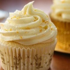 Classic mimosa partners--champagne and OJ--create party cupcakes.