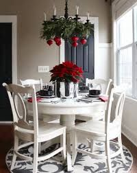 Christmas Dining Room Decor - Chandelier decorated with evergreens and red ornaments, and poinsettias in silver pot Christmas Kitchen, Simple Christmas, Christmas Home, White Christmas, Christmas Holidays, Christmas Island, Christmas Cactus, How To Decorate For Christmas, Christmas Movies