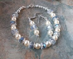 Stunning pearl with iridescent crystal and silver details handmade bracelet with matching earrings by SpryHandcrafted on Etsy