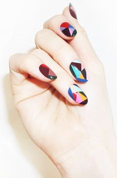 Geometric nails in a rainbow of hues.
