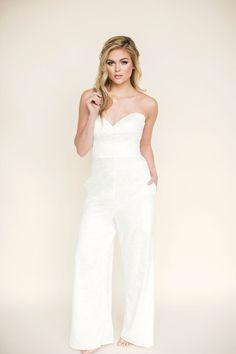 Fitted Wedding Jumpsuit | Jones Darling | This lightweight, lace wedding jumpsuit features a sophisticated sweetheart neckline with a wide-leg pant. It has a natural waistline and pockets. The back is finished with a 2-button closure, cut outs, and a zipper. Visit our website to learn more about this bridal pants suit. #wedding #weddinginspo #bridalinspo #bride #boho #jumpsuit Custom Wedding Dress, Wedding Dress Styles, Boho Wedding Dress, Lace Wedding, Dream Wedding, Wedding Outfits, Wedding Wear, Bridal Pants, Wedding Jumpsuit