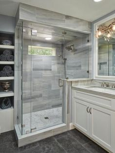 Bathroom with Glass and Marble Shower, Gray Limestone Floors, and Quartzite and Wood Vanity