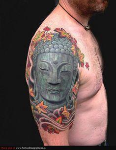 http://www.tattoobite.com/wp-content/uploads/2013/09/buddha-head-tattoo-on-shoulder-2.jpg