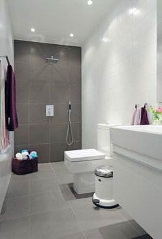 Grey and white large tiles in this simple bathroom.
