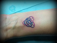 small colorful celtic knot of motherhood on wrist Want to do something very similar, but with their names too. Like the placement...