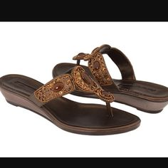 Bandolino sandals!! Super comfortable Bandolino brown sandals. Super neutral and can wear any day!! Bandolino Shoes Sandals