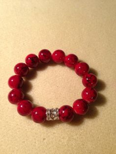 Red beaded stretch bracelet from mrstammysjewelry on etsy