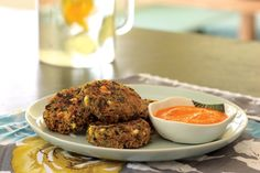 Crispy Quinoa Cakes Recipe | Vegetarian Times - egg, allowed flour, tahini or nut butter, vinegar, cooked quinoa, grated sweet potato, frozen spinach, sun-dried tomatoes, nuts, feta (untested, optional), onion, fresh parsley, garlic, salt - red pepper sauce also uses tested ingreds.