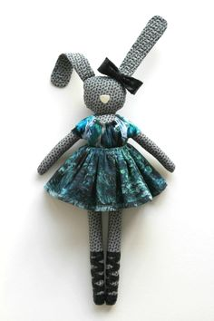 fabric Bunny - I had these as a kid. One large rabbit with pockets in her dress for smaller ones