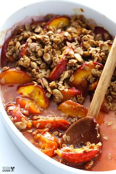 """This Ginger Peach Crumble is made with a delicious fresh and sweet peach filling, and topped with a crispy oatmeal-almond """"crumble""""."""