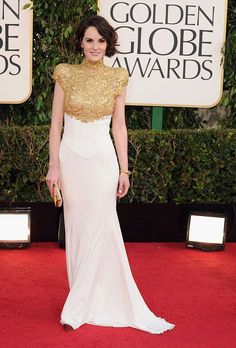 "Michelle Dockery:  Lady Mary was lovely! The nominated ""Downton Abbey"" actress opted for a classically beautiful white-and-gold Greecian gown. She finished off her vintage look with a gold clutch, bracelet, and emerald-and-diamond earrings."