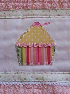 Cute cupcake appliqued onto a tea towel.