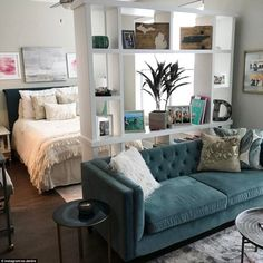 While xo.deidre's decor is neutral a teal velvet sofa with a furry white cushion on next to a grey textured rug takes her space from plain to enviable