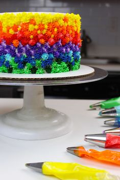 This colorful buttercream cake is made with rainbow marble cake layers, and decorated with rainbow frosting! It's the perfect cake to brighten any party! Rainbow Marble Cake Recipe, Rainbow Frosting, Marble Cake Recipes, Rainbow Cakes, Rainbow Baby, Piping Frosting, Homemade Buttercream Frosting, Vanilla Frosting, Icing