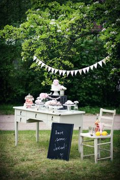 rustic pink dessert table. beyond darling!!! on this table is bluberry cake with homemade bluberry jam, lemon curd and meringue frosting, chocolate macarons, lemon macarons, chocolate cupcakes, meringues and lemonade.
