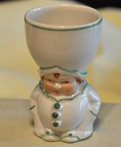 "Kompletely adorable Klown egg kup dressed in an all white costume with green accent colors. Marked ""Japan"" on the bottom."