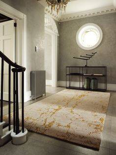The use of our opulent 'Levantine Gold' rug  in this hallway makes the space both dramatic and classy  Luxury modern rugs London