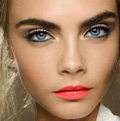 Beautiful as always - Cara Delevingne! Seems like bright eyes will be big this summer!
