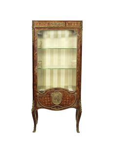 A French late 19th century ormolu-mounted kingwood and parquetry vitrine