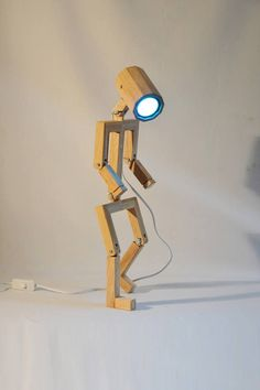 Articulated Design lamp Madame Made from recycled wood