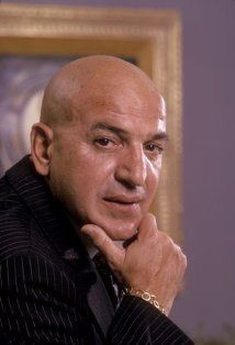 Telly Savalas was in the USA during WWII from 1943-1944 working for the US State Department as a host of Your The Voice of America series.