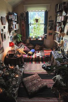 my ideal bedroom. texture colour comfort, a working alter, loads of vintage books a great view and loads of light to draw under.