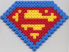 Well, this is the most fitting category I could find. Perler beads have, for some reason, become my new favourite arts and crafts activity. Superman Shield in Perler Bead Hama Beads, Fuse Beads, Perler Bead Designs, Hama Bead Boards, Minecraft Beads, Iron Beads, Melting Beads, Peyote Beading, Perler Patterns