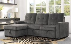 """9402DGY*SC Winston porter cadence II dark gray fabric reversible sectional sofa with storage chaise. Features a reversible chaise with storage , pull out sleep area and adjustable headrests all with pocket coil seating. Measures 91.5"""" x 61"""" x 38"""" H. Some assembly required."""